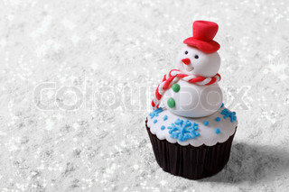 Cupcake Christmas snowman on white snow. horizontal | Stock Photo ...