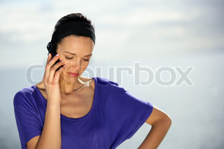 Woman making an important call from the seaside