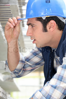 Construction worker touching the brim of his hat