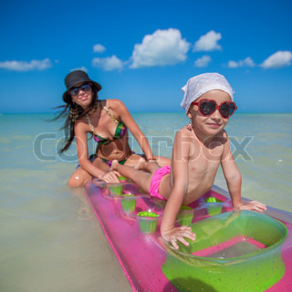 Little girl with air mattress on summer vacation at ...