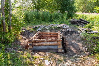 Construction of wooden water well in countryside