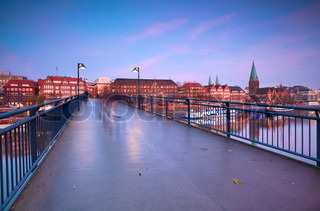 view on sunset over Bremen city from bridge