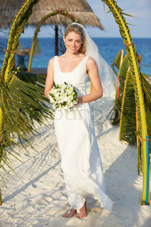 Beautiful bride getting married in beach ceremony stock for Beach wedding dresses for older brides