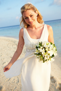 Beautiful bride getting married in beach ceremony stock for Wedding dress resale dallas