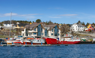 Fishing boats stand moored in Norway village