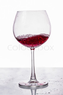 A glass of red wine isolated on white background