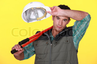 Construction worker wiping his brow