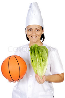 happy attractive cook woman with basketball ball