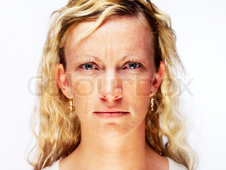 Portrait of a woman squinting her eyes