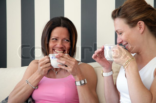 Smiling women with cups of coffee