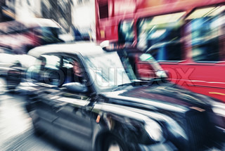 Motion blur picture of Black Cab and Red Double Decker Bus in the heart of London