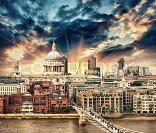 London. Beautiful aerial view of Millennium Bridge and St Paul Cathedral at sunset