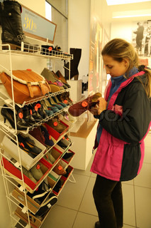 A woman buys shoes