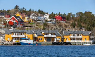 Norwegian fishing village with wooden houses on the sea coast