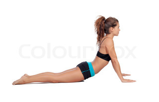 Attractive woman doing pilates exercises