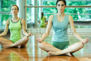 Image of 'siddhasana, women, indoor'