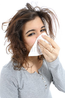 Close up of a woman with flu and  a handkerchief in the nose