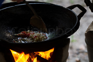 cook on pan at the charcoal brazier