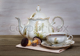 Still life with tea and cookies in the shape of a mushroom