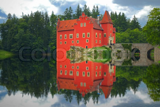 Reflection of the red castle on the lake.