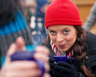 Women on Christmas market drinking punch
