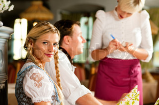 Waitress in Bavarian restaurant taking orders