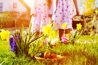 Children on Easter egg hunt with eggs