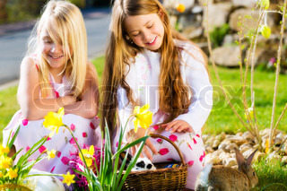 Children on Easter egg hunt with bunny