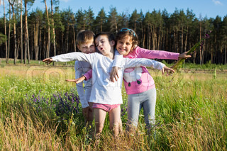 children sit on meadow person