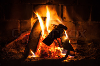 Natural photo background with fire in fireplace