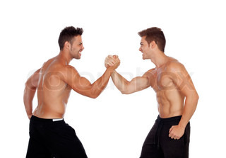 Couple of handsome muscled men competing
