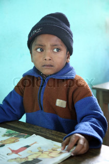 Portrait of schoolboy at school in Kumrokhali, West Bengal, India