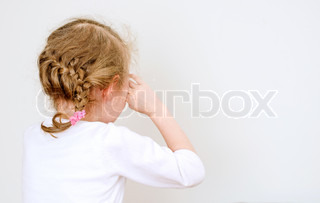 Little girl crying in the corner.