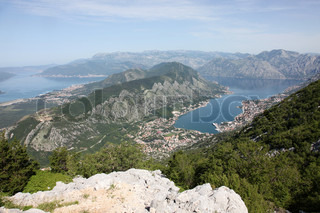 Panorama UNESCO World Heritage Site bay of Kotor with high mountains plunge into adriatic sea and Historic town of Kotor, Montenegro