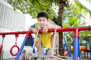 Asian cute boy playing in the park