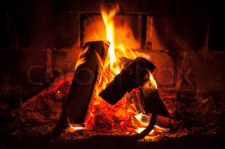 Natural photo background with fire in dark fireplace