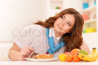 Young woman choosing a diet
