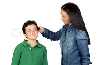 Mother pulling her child's ear for being naughty