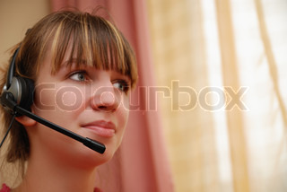 Smart young woman using head-set