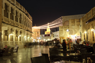 Souq Waqif street at night with many cafes and restaurants. Doha, Qatar, Middle East
