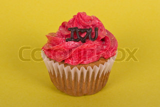 Valentine cupcake on yellow background with I love you message