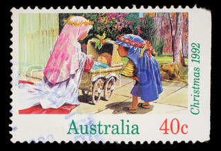 Stamp printed in Australia shows children playing to the Holy Family