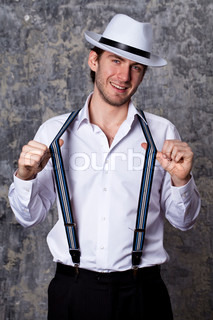 Young man in a white shirt and cowboy hat