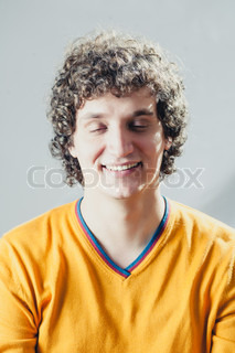 Detailed portrait of a young caucasian guy with curly hair
