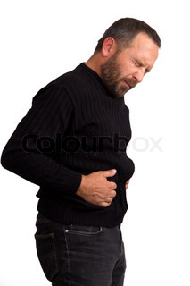 Young man suffering from a bad stomach ache pain isolated on white background