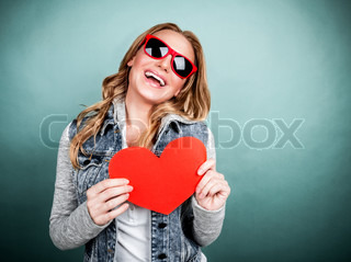 Cheerful female with paper heart