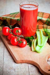 tomato juice in glass, fresh tomatoes and green celery