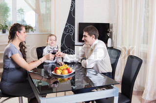 Young family celebrating at home