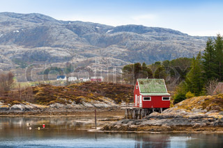 Old red wooden house stands on the sea coast in norway stock photo colourbox - The house on the rock the ultimate refuge in a norwegian fjord ...