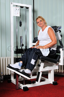 Mature  woman work out in fitness